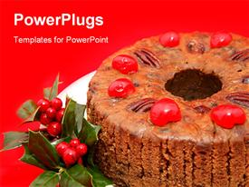 PowerPoint template displaying close-up view of a moist delicious holiday fruitcake garnished with holly in the background.