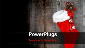 PowerPoint template displaying christmas sock and wreath on old barn board wood in the background.