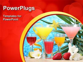 Exotic cocktails and flowers on table on blue sea background powerpoint theme