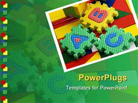 PowerPoint template displaying colored ABC blocks on colorful surface in green background