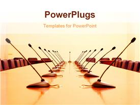PowerPoint template displaying microphones in empty conference room, business concept in the background.