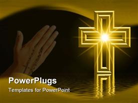 Golden cross reflected in water with light burst star effect in middle of cross and room for text powerpoint template