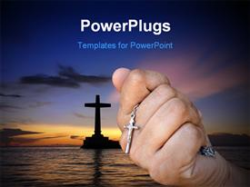 PowerPoint template displaying close-up of hand holding a silver cross