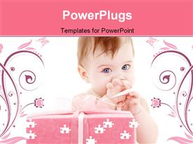 PowerPoint template displaying puzzle depiction of baby boy with big gift box in the background.