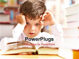 PowerPoint template displaying young boy looking at camera while reading book