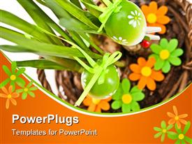 Easter eggs on green plant and flowers template for powerpoint
