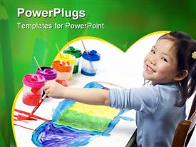 PowerPoint template displaying a kid with a number of various paints in the background