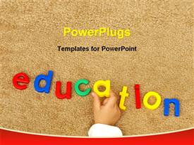 PowerPoint template displaying education text with a hand on a sand looking background