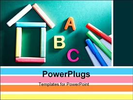 Close-up of chalk house letters and highlighters on blackboard powerpoint design layout
