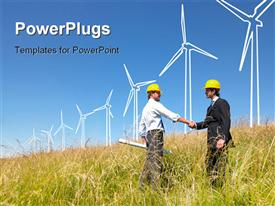 PowerPoint template displaying engineers in field with plans building windmills