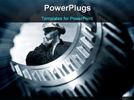Engineer seen through the shaft of a giant gear wheel, duplex blue toning concept powerpoint design layout