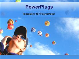 PowerPoint template displaying lady in sun glasses watching hot air balloons floating