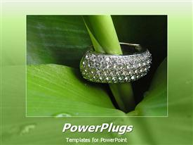 PowerPoint template displaying a beautiful plant with jewelry placed on it and green background