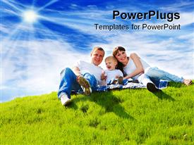PowerPoint template displaying beautiful cheerful family sitting on the green hill