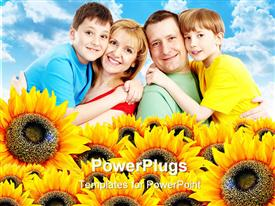 PowerPoint template displaying family of four smiling happily with lots of sunflowers