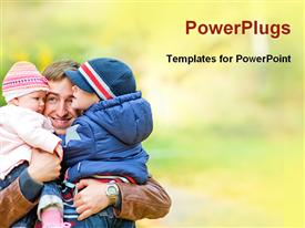 PowerPoint template displaying an adult male holding two small children and smiling
