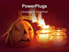 PowerPoint template displaying halloween jack o lantern, burning candles, orange background