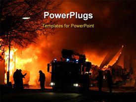 PowerPoint template displaying firemen at work during a major fire at night in the background.