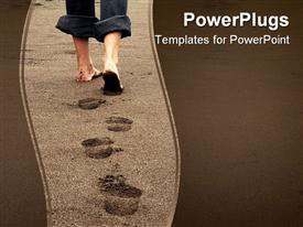 PowerPoint template displaying feet of a person leaving footprints on a beach on sandy background