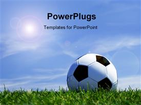 PowerPoint template displaying soccer ball on grass depicting sports concept with beautiful blue sky