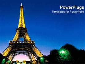 PowerPoint template displaying night view of the Eiffel tower in France with lights