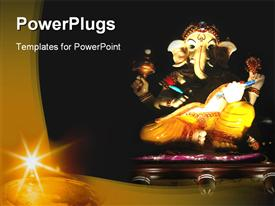 PowerPoint template displaying statue of Hindu elephant god Ganesha, religion, Hinduism
