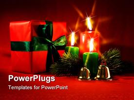 PowerPoint template displaying burning Xmas candle little gift box and golden hand bells in the background.
