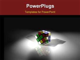 PowerPoint template displaying a rubix cube under a spot light on a white background