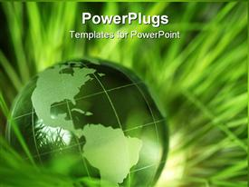 PowerPoint template displaying a green colored earth globe on a pile of green grass