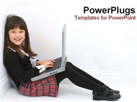 PowerPoint template displaying a kid working on a laptop