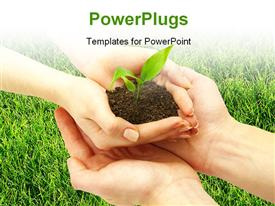 PowerPoint template displaying holding a plant between hands on grass in the background.