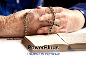 Elderly pair of hands holding a cross template for powerpoint