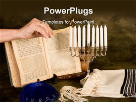PowerPoint template displaying female hand lighting the candles for Hanukkah in the background.