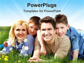 PowerPoint template displaying couple with two kids lying on flowery vegetation