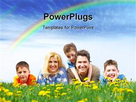 PowerPoint template displaying a family sitting in the field with rainbow in background