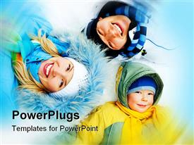 PowerPoint template displaying young parents and their son wearing warm winter clothes lie on the snow