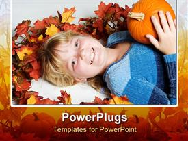 PowerPoint template displaying happy girl lying down, smiling and holding a pumpkin