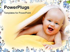PowerPoint template displaying a cute smiling bay wrapped with a yellow towel