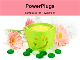 PowerPoint template displaying candle in a lemon green casing with flowers and stones