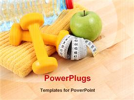 PowerPoint template displaying dumbbells towel and green apple - ready to fitness