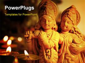 PowerPoint template displaying an idol of a Hindu God Krishna and Radha with lighted candles