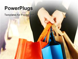 PowerPoint template displaying a girl holding a number of shopping bags with blurred background