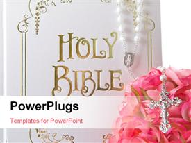 PowerPoint template displaying the holy bible with a lot of roses and a cross