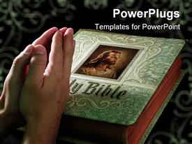 PowerPoint template displaying pair of adult hands clasped together praying on a Bible