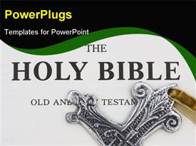 Silver religious cross sitting on a bible template for powerpoint