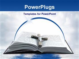 PowerPoint template displaying wooden cross and metal Jesus on open religious book