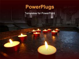 PowerPoint template displaying a lot of candles being burnt with a church in background