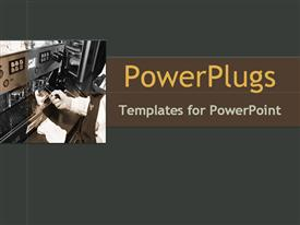 PowerPoint template displaying pair of hand operating a machine on an ash colored background