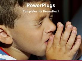 PowerPoint template displaying a boy praying with blackish background