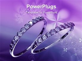 PowerPoint template displaying two shiny crystal wedding rings on a purple background